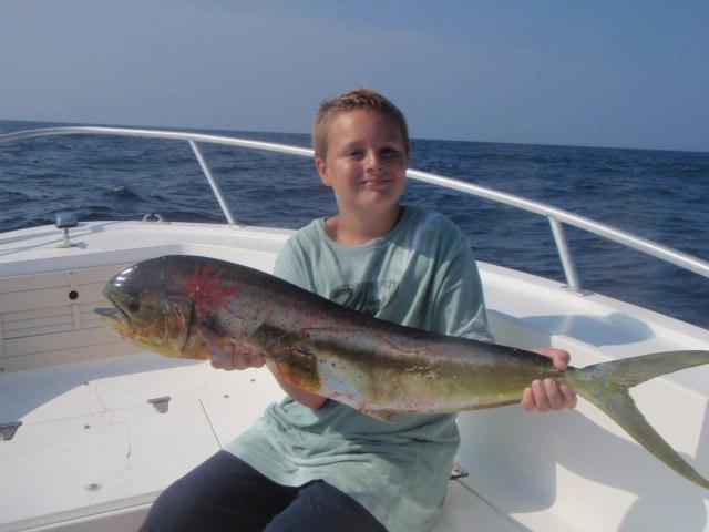 Alex Crawford age 9 from Ohio with his first mahi mahi caught with Captain John