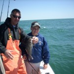Joe Cordero and Captain Jim with a black seabass we released.